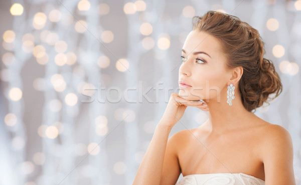 beautiful woman wearing shiny diamond earrings Stock photo © dolgachov