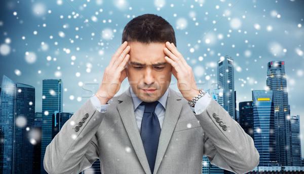 businessman in suit having head ache Stock photo © dolgachov