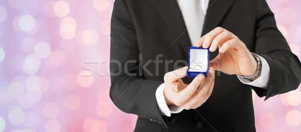 close up of man with gift box and engagement ring Stock photo © dolgachov