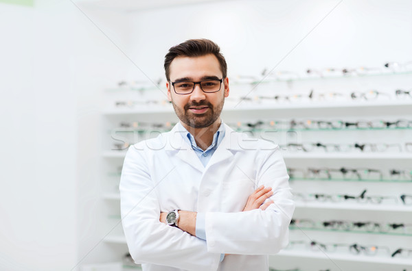 man optician in glasses and coat at optics store Stock photo © dolgachov