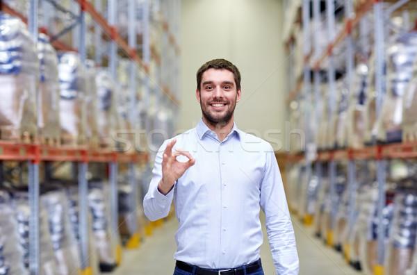happy man at warehouse showing ok gesture Stock photo © dolgachov