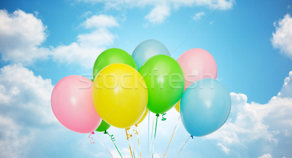 bunch of inflated helium balloons over blue sky Stock photo © dolgachov