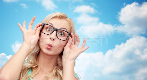 Gelukkig jonge vrouw bril vis gezicht Stockfoto © dolgachov