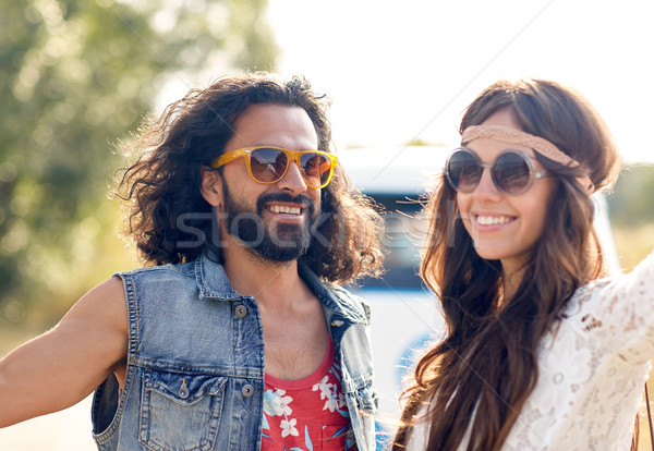smiling young hippie couple over minivan car Stock photo © dolgachov