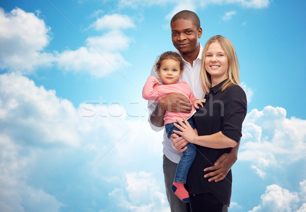 happy multiracial family with little child Stock photo © dolgachov