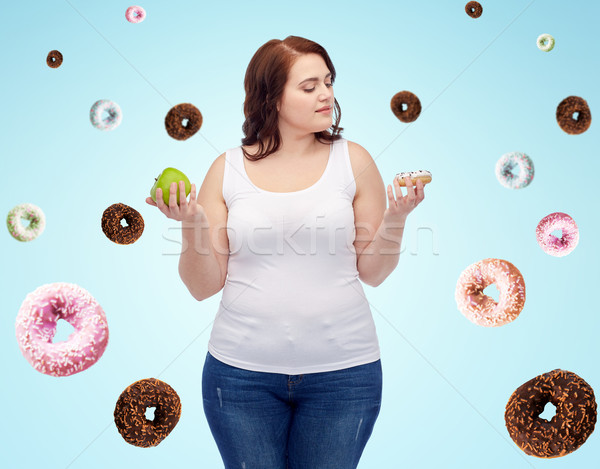 young plus size woman choosing apple or cookie Stock photo © dolgachov