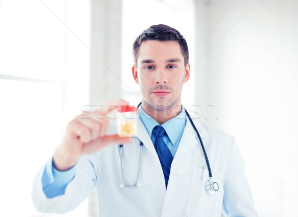 male doctor with jar of capsules Stock photo © dolgachov