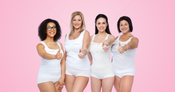 group of happy different women showing thumbs up Stock photo © dolgachov