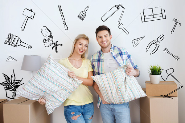 happy couple with stuff moving to new home Stock photo © dolgachov