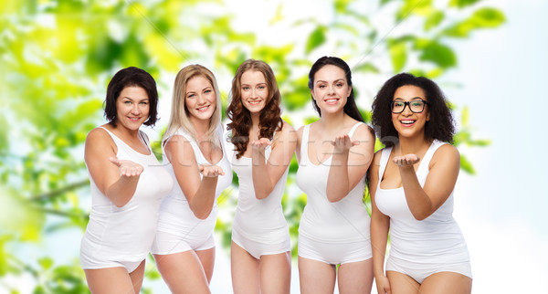 Stock photo: group of happy different women sending blow kiss