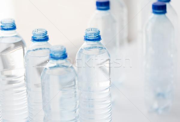 Közelkép üvegek ivóvíz asztal újrahasznosítás egészséges étkezés Stock fotó © dolgachov