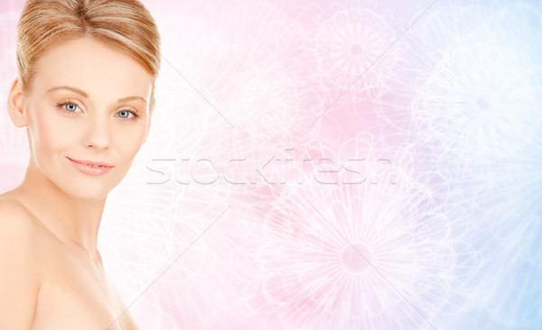 beautiful young woman face over beige background Stock photo © dolgachov