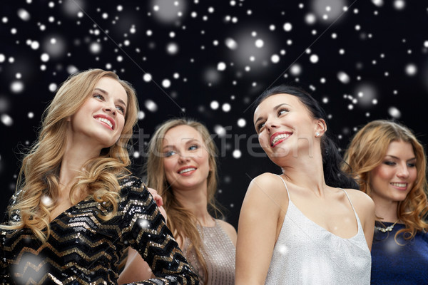happy young women dancing over snow Stock photo © dolgachov
