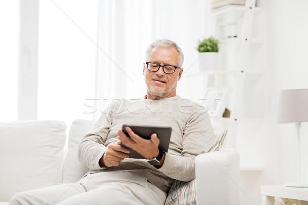 senior man with tablet pc at home Stock photo © dolgachov
