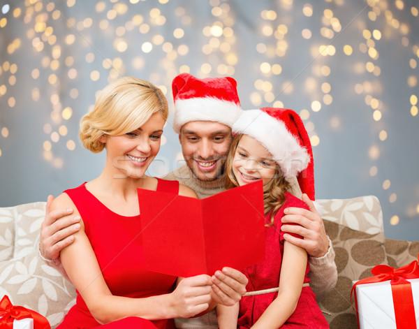 Boldog család olvas karácsony képeslap ünnepek emberek Stock fotó © dolgachov