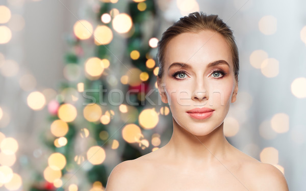 beautiful woman face over christmas lights Stock photo © dolgachov