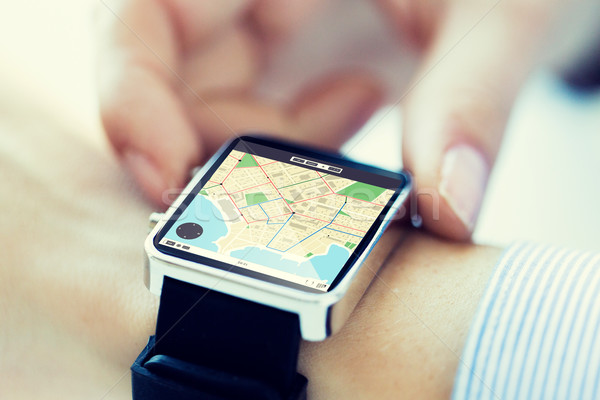 close up of hands with map on smartwatch screen Stock photo © dolgachov