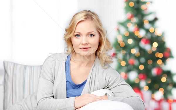 middle aged woman sitting on sofa at christmas Stock photo © dolgachov