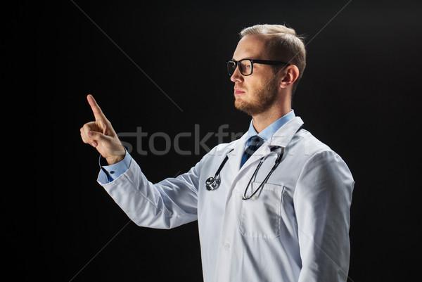 doctor in white coat with stethoscope Stock photo © dolgachov