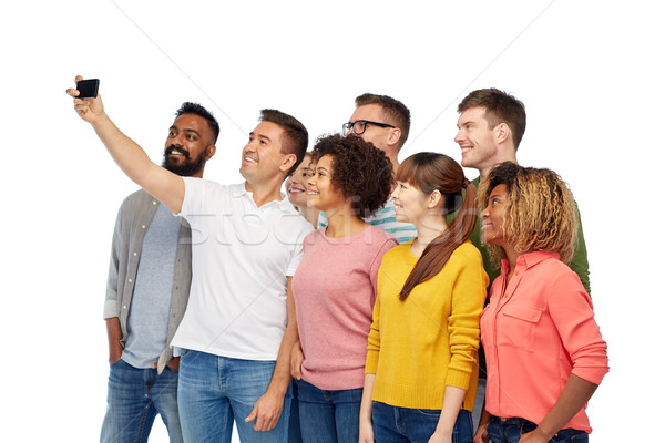 Stock photo: group of people taking selfie by smartphone