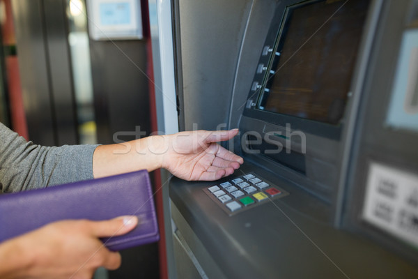 close up of hands withdrawing cash at atm machine Stock photo © dolgachov