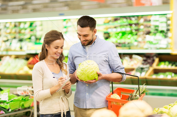 couple with food basket shopping at grocery store Stock photo © dolgachov