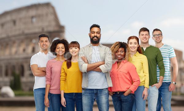 international group of people over coliseum Stock photo © dolgachov