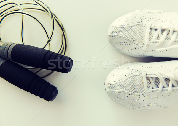 close up of sneakers and skipping rope Stock photo © dolgachov