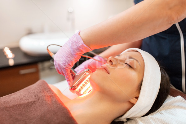 young woman having face microdermabrasion at spa Stock photo © dolgachov