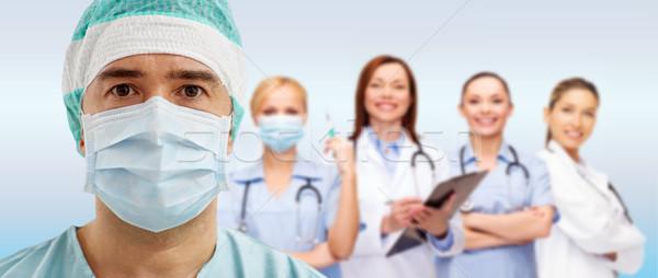 Cirujano máscara grupo azul cirugía salud Foto stock © dolgachov