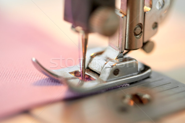sewing machine presser foot stitching fabric Stock photo © dolgachov