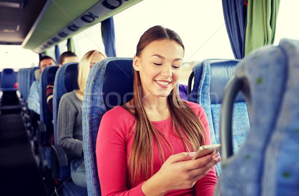 Heureux femme séance Voyage bus smartphone Photo stock © dolgachov