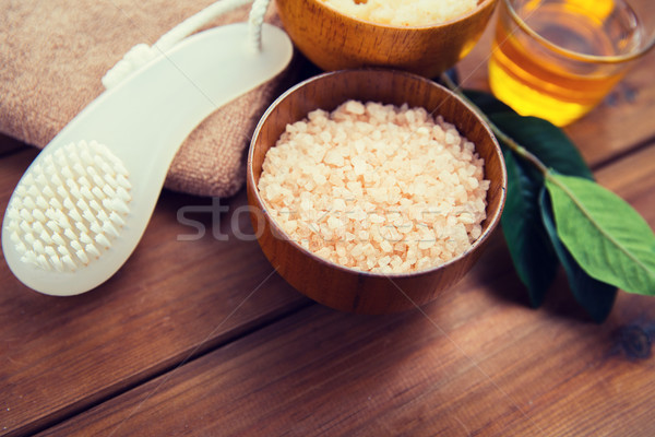 close up of himalayan pink salt with brush on wood Stock photo © dolgachov