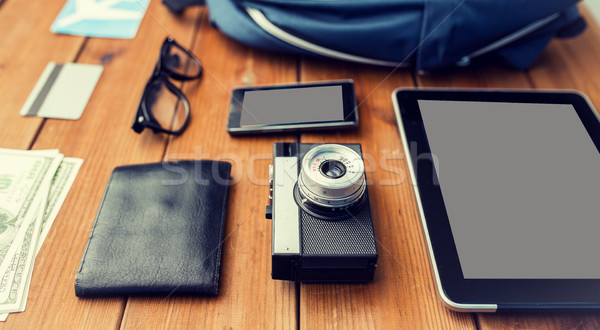 close up of camera, gadgets and travel stuff Stock photo © dolgachov