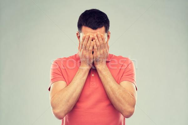 男 Tシャツ 顔 手 人 危機 ストックフォト © dolgachov