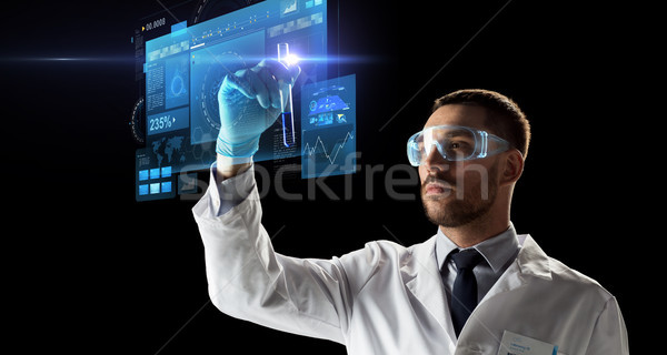 scientist in goggles with test tube virtual screen Stock photo © dolgachov
