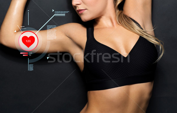close up of woman in black sportswear with pulse Stock photo © dolgachov