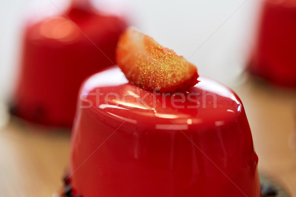 close up of mirror glaze cake at confectionery Stock photo © dolgachov