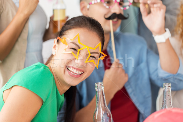 happy woman with friends having fun at party Stock photo © dolgachov