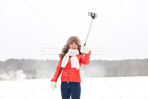 Stockfoto: Gelukkig · vrouw · stick · buitenshuis · winter · mensen
