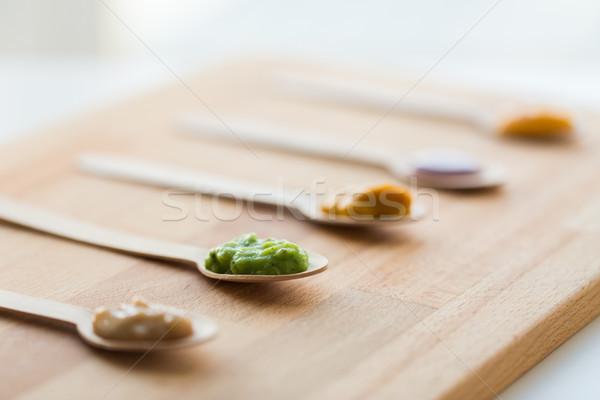 vegetable or fruit puree or baby food in spoons Stock photo © dolgachov