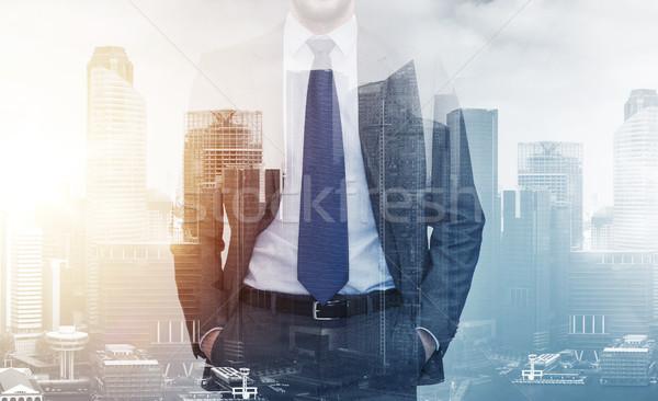 Empresário cidade edifícios pessoas de negócios dobrar Foto stock © dolgachov