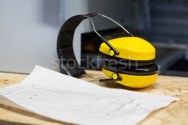 industrial earmuffs and bill on table at workshop Stock photo © dolgachov