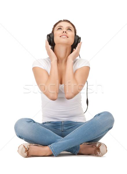 Szczęśliwy duży słuchawki zdjęcie kobieta Zdjęcia stock © dolgachov