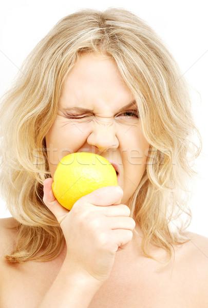 Stock photo: lovely blond biting lemon
