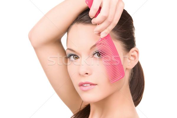 Vrouw kam heldere foto mooie vrouw gezicht Stockfoto © dolgachov