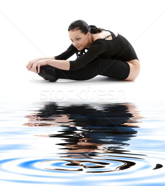 fitness in black leotard on white sand #2 Stock photo © dolgachov