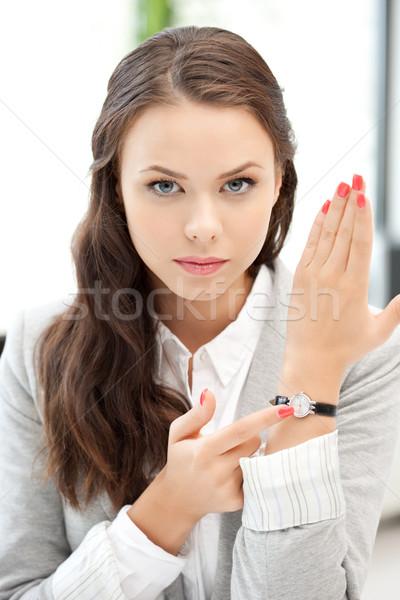 businesswoman with watch Stock photo © dolgachov