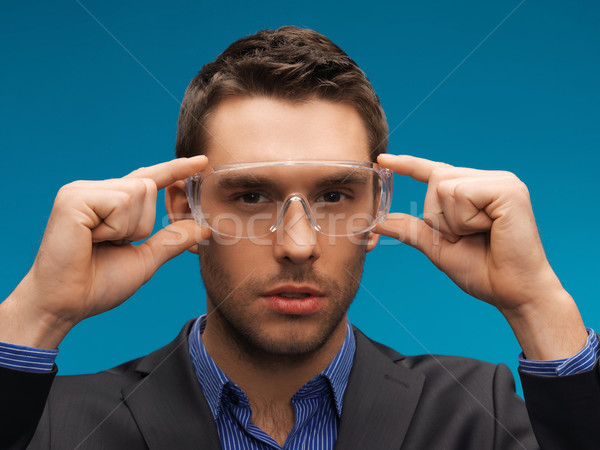 businessman in protective glasses Stock photo © dolgachov