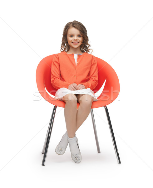 pre-teen girl in casual clothes sitting on chair Stock photo © dolgachov